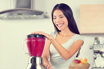 Smoothie woman making fruit smoothies