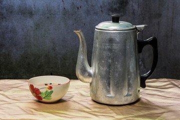 still life classic kettle with cup and lamp