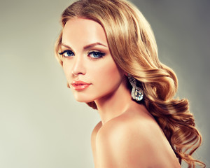 Beautiful model blond with curly hair and fashion earings