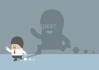 Businessman followed by debt shadow