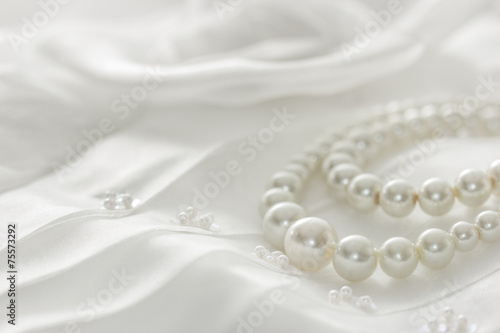 Pearl necklace on lace background,selected focus. - 75573292