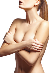 Sexy woman hiding her breast. White background.