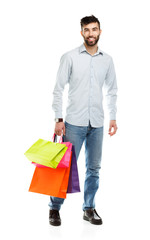 Handsome man holding shopping bags