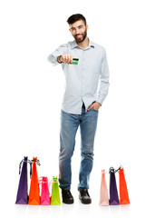 Handsome man with shopping bags and holding credit card