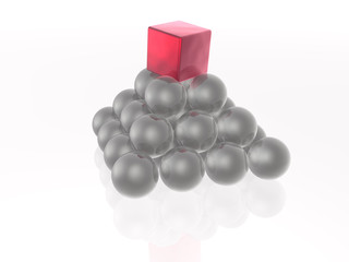 Red cube and grey spheres