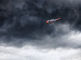 Helicopter in Norway seen from below in front dramatic sky