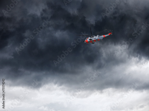 Foto op Canvas Helicopter Helicopter in Norway seen from below in front dramatic sky
