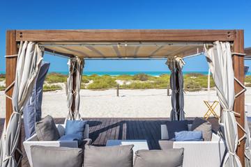 Armchairs on a beach