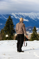 man looking to a mountain winter landscape