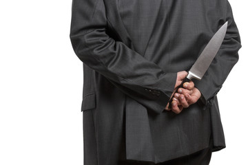 Man in suit with large knife