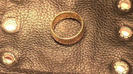 Gold Ring on Black Leather