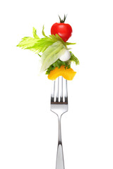Mixed salad on fork isolated on white