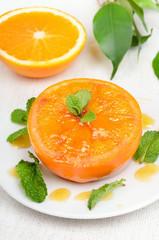 Baked orange fruit decorated mint