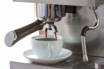 espresso in coffee bar; close-up