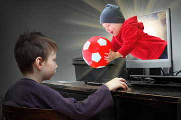 Little boys playing online pc game. Virtual reality concept.