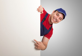 Worker pointing his finger to a blank board