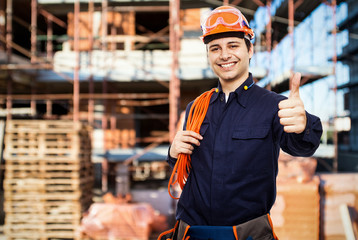 Smiling worker in a construction site