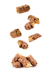chocolate bars falling on a white background