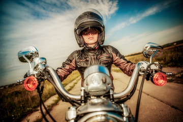 Biker girl on a motorcycle