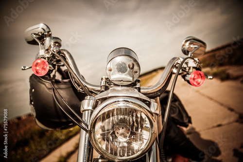 Motorcycle on the road - 75579088