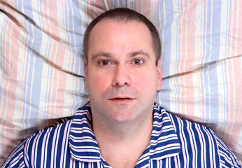 lying man resting in bed