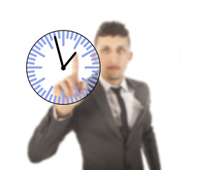 Young businessman with clock isolated