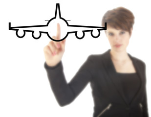 Young businesswoman with plane isolated