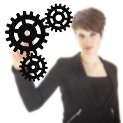 Young businesswoman with black gears isolated