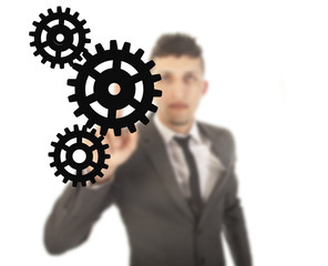 Young businessman with black gears isolated