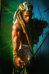 Muscular man with dreadlocks werewolf on a colorful background.
