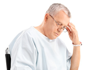Worried mature patient looking down