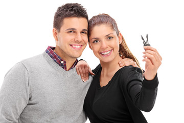 Young couple posing with a pair of door keys