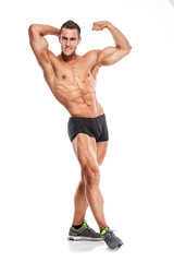 Strong Athletic Man Fitness Model Torso showing six pack abs. an