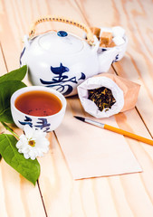blank card and chinese set tea on wooden table