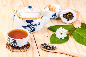 Chinese set of tea on wooden table