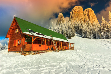 Colorful winter sunset and shelter,Carpathians,Romania,Europe