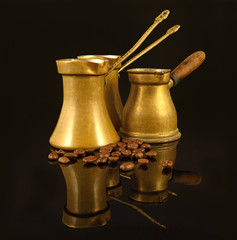 Old copper Cezves. Turkish Coffee Pot and Beans on black