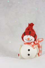 One smiling snowman