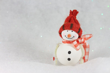 Funny snowman on bright background,with copy space