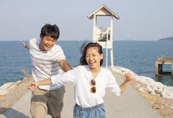 young man and pretty woman joyful emotion and playing at sea sid