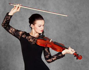 Portrait of a young attractive violinist woman