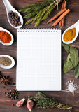 Fresh herbs, different spices notebook on the table - 75584010