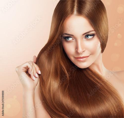 Fototapeta Beautiful girl with brown hair .Long straight hair Shine