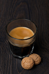 glass of espresso and almond cookies, selective focus