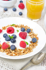 homemade muesli with yogurt, raspberries, blueberries