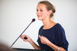 Pretty, young business woman giving a presentation - 75585698