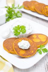 pumpkin pancakes with feta cheese sauce, vertical