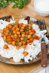white rice with chickpeas in tomato sauce, vertical