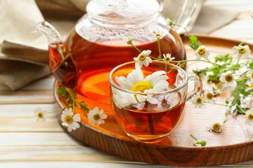 Organic herbal green tea with fresh chamomile flowers
