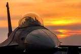 Fototapety f16 falcon fighter jet on sunset  background